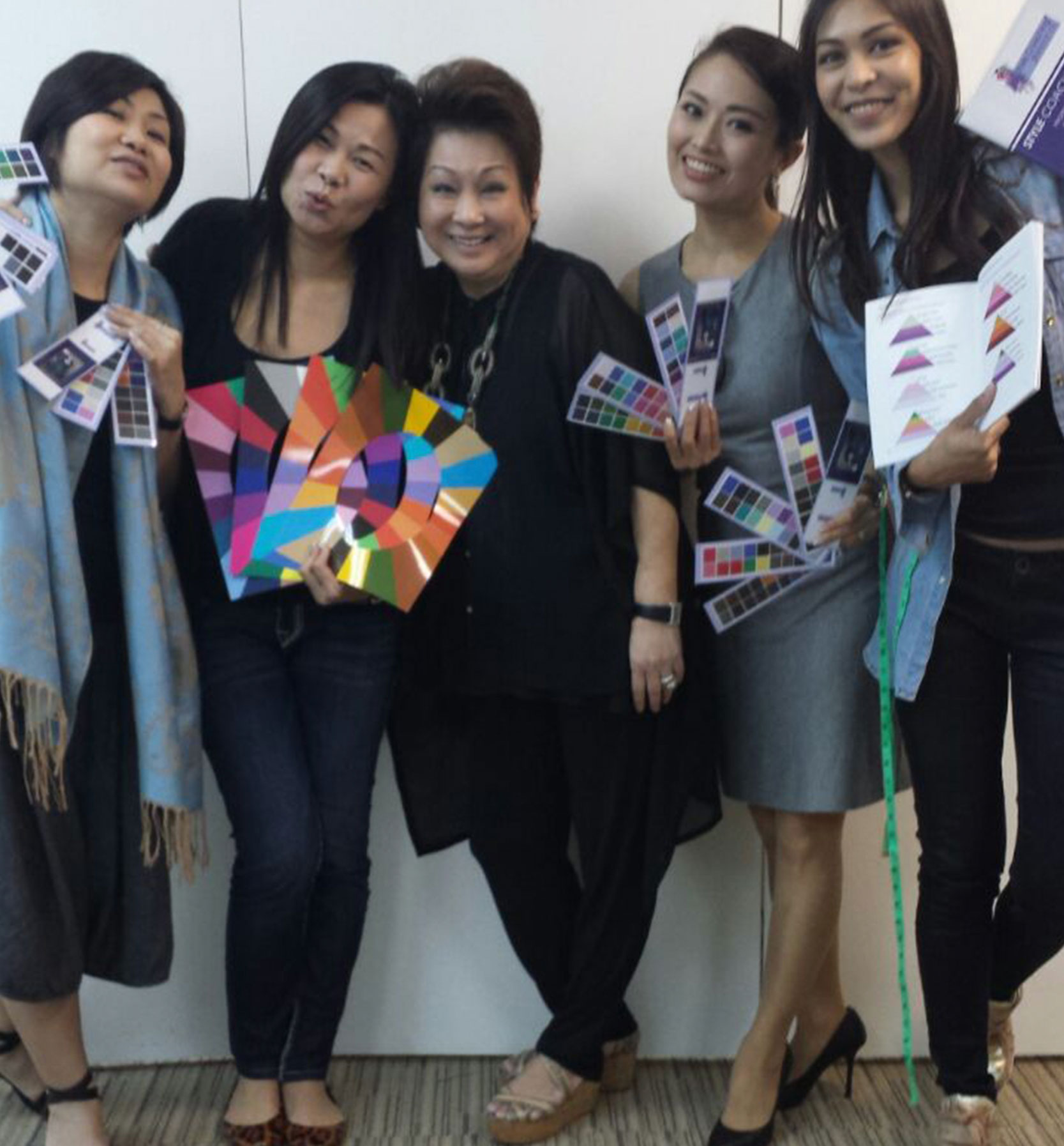 Theresa Huang a hosts in Singapore with her students