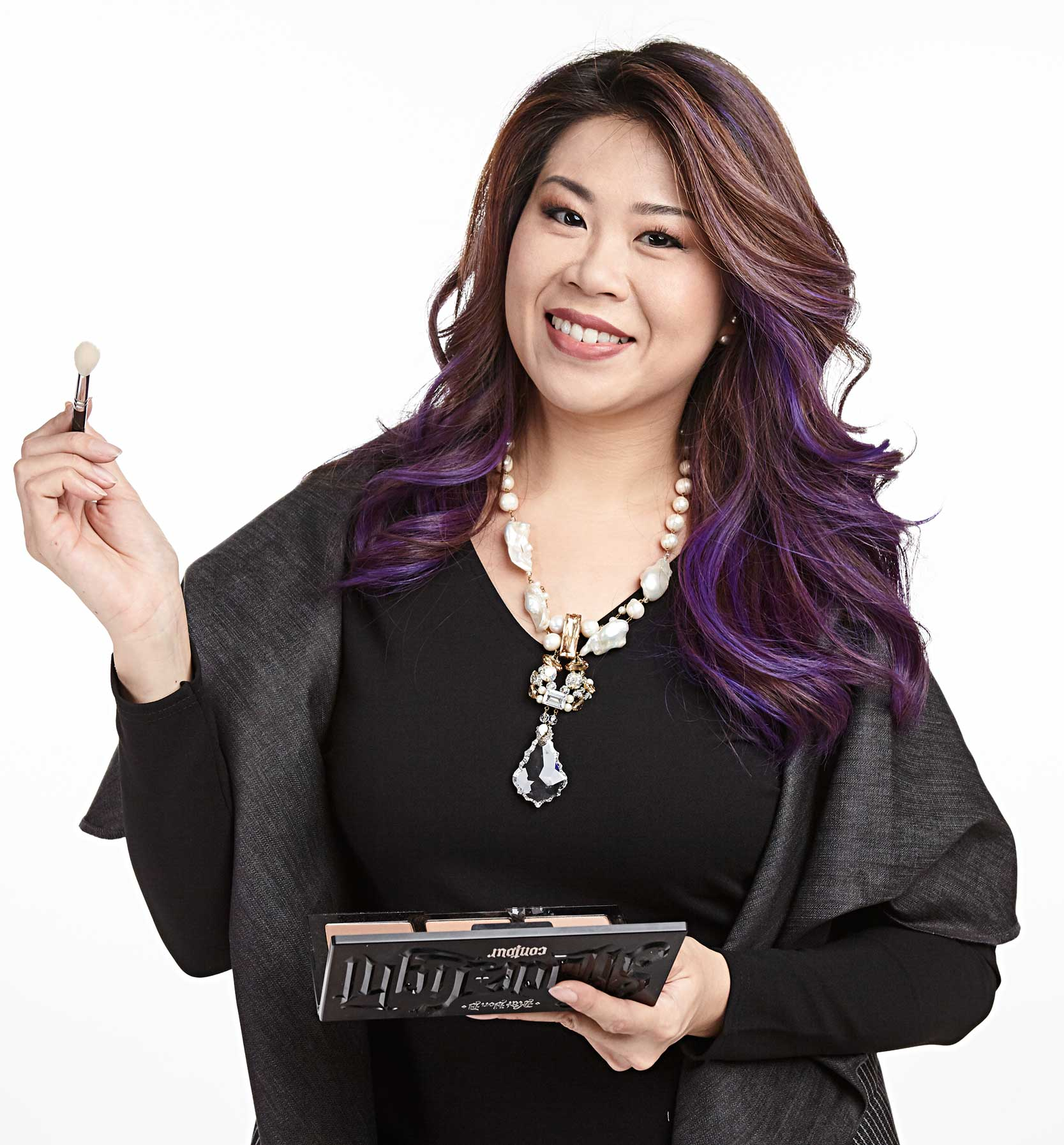 Style Coaching - Singapore - Training team member smiling with make-up brush in her hand