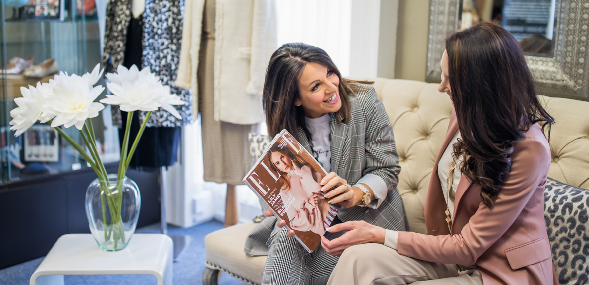 Tracey Redmond & Kate Redmond Directors of the Style Coaching Institute sitting looking at a magazine